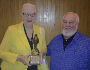 A photo of J.A. Jance and her husband Bill, proudly holding the Buochercon Guest of Honor Award