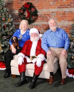 Photo of Bill, Judy, and Bella with Santa